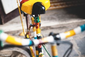 Brightly painted old bicycle can add a touch of color and fun to your winter landscape. Photo by Peter Hershey.